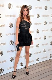 Elisabetta Canalis struck a fierce pose at the Roberto Cavalli boutique opening in black peep-toe ankle strap heels.