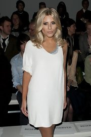 Mollie kept it short in this spicy white asymmetrical shift dress at London Fashion Week.