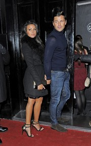 Michelle Keegan matched her shoes with a black and gold clutch.