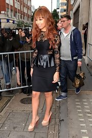 Rebecca Ferguson flawlessly paired nude Christian Louboutin platform pumps with her chic LBD.