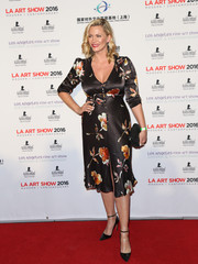 Natasha Henstridge went the demure and ladylike route in this floral satin dress during the LA Art Show opening.