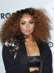 Kat Graham rocked frizzy hair at the Rogue Magazine launch party.