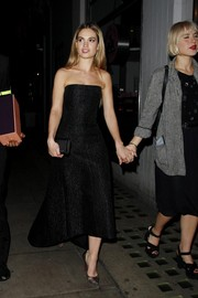 Lily James went clubbing wearing an elegant black strapless dress.