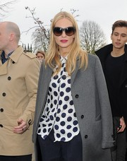 Poppy Delevingne arrived for the Burberry fashion show wearing a pair of oversized shades.