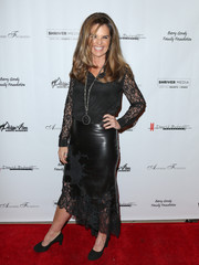 Maria Shriver paired her blouse with a complementary leather and lace pencil skirt.