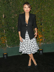 Jeannie Mai flaunted some cleavage in a black blazer layered over just a bra during the opening of Cirque Du Soleil's 'Kurios.'