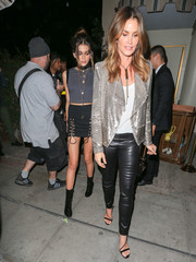 Cindy Crawford was rocker-glam in a silver IRO sequin jacket teamed with black leather pants during Kendall Jenner's 21st birthday party.