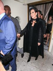 Kris Jenner looked quite the diva in a black velvet cape during Kendall's 21st birthday party.