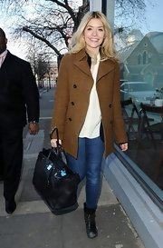 Holly Willoughby opted for a class but casual look with this brown tweed jacket.