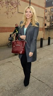 Holly Willoughby chose a long gray coat to top off her sophisticated look while heading to 'Celebrity Juice.'