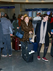 Florence Pugh was spotted at Salt Lake International Airport pushing a large black nylon suitcase.