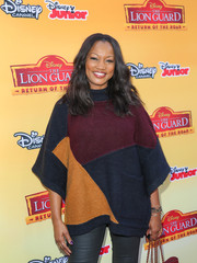 Garcelle Beauvais kept warm in cute style with a color-block turtleneck poncho while attending the 'Lion Guard: Return of the Roar' premiere.