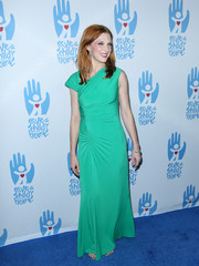 Lucy Walsh donned an asymmetrical aqua-green evening dress for the Save a Child's Heart Gala.