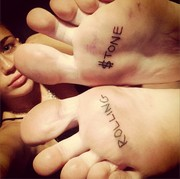Miley Cyrus celebrated her 'Rolling Stone' cover by having the words tattooed on the soles of her feet!