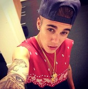 Justin Bieber accessorized with layers of gold pendant necklaces for this social media pic.