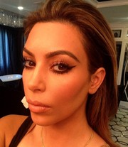 Kim Kardashian showed off a perfectly done smoky cat eye on social media.
