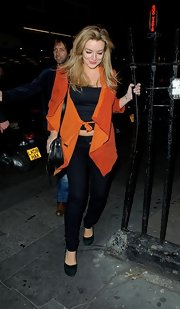 Sheridan Smith chose this bright orange suede jacket while going out in London.