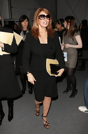 Raquel Welch was seen backstage a Michael Kors' show wearing an LBD topped with a fitted blazer.