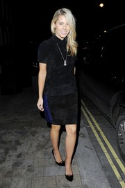 Mollie King teamed her top with a matching black suede mini skirt.