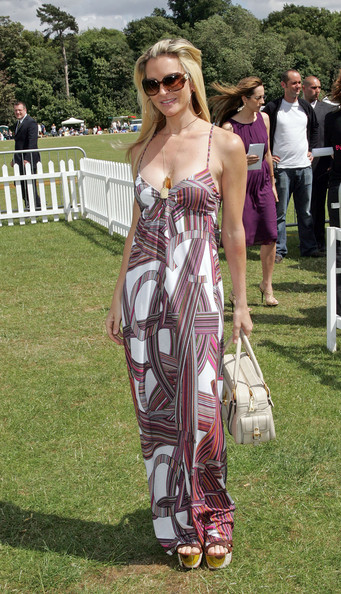 Caprice was snapped in a summery abstract print maxi dress at The Duke of Essex Polo Trophy Match in Essex.