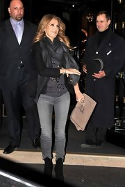 Celine Dion carried an oversized nude leather clutch while leaving the Four Seasons hotel in Paris.