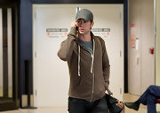 Chace paired his gray baseball cap with a brown hoodie.