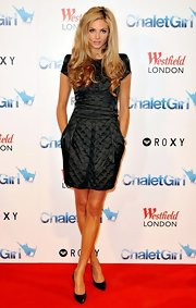 Tamsin Egerton was all dolled up for the 'Chalet Girl' premiere wearing a quilted satin dress.