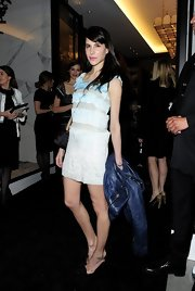 Caroline Sieber wore a light white and blue paneled frock to the Chanel VIP party in London.