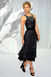 Clemence Poesy dazzled in a delightful beaded cocktail dress with sheer overlay.