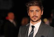 Zac Efron wore his famous hair in a perfectly wind swept side-part.