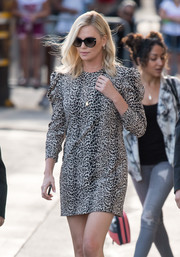 Charlize Theron headed to 'Jimmy Kimmel' looking chic in her Ferragamo butterfly sunnies.