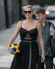 Charlize Theron was spotted outside 'Kimmel' wearing chic cateye sunnies and a lace dress.