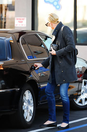 "The almost 5'10"" actress opts for black ballet flats with her skinny jeans and wool coat. These comfy and cute shoes are great for a girl on the go."