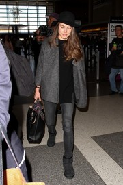 Gray sheepskin boots completed Charlotte Casiraghi's airport look.