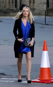 Chelsy Davy attended a wedding in a ruffled blue silk gown.
