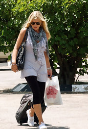 Chelsy Davy looked casual in cropped black leggings and a ruffled tunic tank.