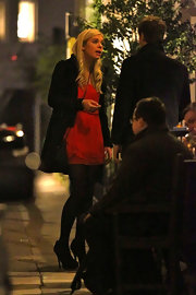 Chelsy Davy dazzled in a flirty red chiffon cocktail dress.