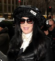 Cher tried to go incognito in Paris with a pair of wayfarers and a huge hat.
