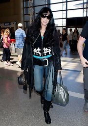 Cher channeled her inner hippie with this black leather coat that featured fringed detailing.
