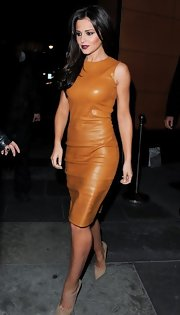 Cheryl brought the va-va-voom to the city in this fitted cognac leather sheath dress.
