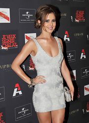 Cheryl paired her stunning silver frock with a spiked bangle bracelet.
