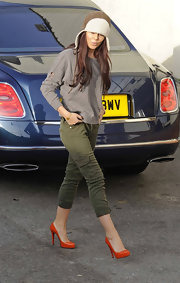Cheryl Cole dressed up her cropped skinny cargo pants with a pair of fiery red pumps.