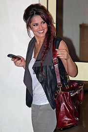 Cheryl Cole sported a fresh hairstyle complete with red hair-dye and a fish-bone braid.