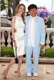 Laura Weissbecker posed with Jackie Chan in this sweet white satin cocktail dress.