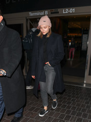 Chloe Grace Moretz rounded out her airport look with a pair of black slip-ons by Vans.
