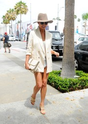 Chrissy Teigen finished off her neutral-toned ensemble with a studded, chain-strap leather bag by Valentino.