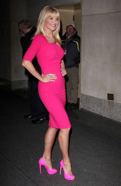 Christie Brinkley arrived for an appearance on the 'Today' show wearing a pair of hot pink peep toe pumps to match her vivid fuchsia dress.