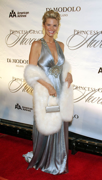 Christie opts for an updo that cleverly shows off her silver halter top dress.