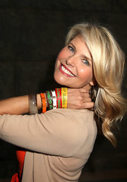 "Ms. Brinklie shows off her arm candy which promote the ""Stop Global Warming"" initiative."