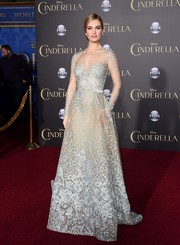 Lily James looked ethereal in a sheer-sleeved, embroidered ice blue gown.